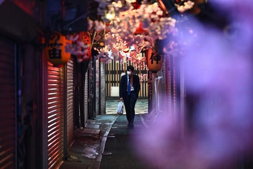 A man wearing a face mask walks in Japan on April 12, 2020.