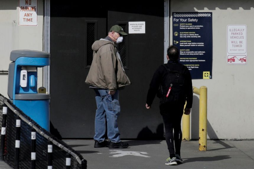 Workers enter the Boeing Everett Factory, amid the coronavirus outbreak, in Everett, Washington.