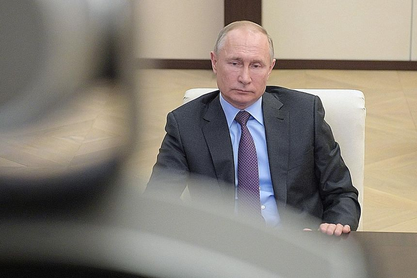 With oil markets collapsing, Russian President Vladimir Putin agreed to cut more than 2.5 million barrels a day of crude, more than four times the reduction that he turned down early last month.