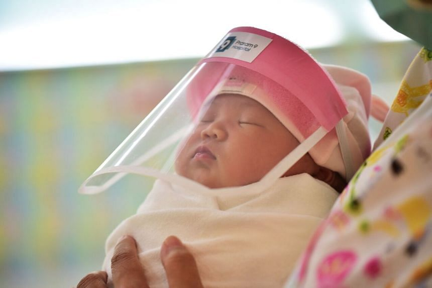 A newborn baby wearing a face shield in Bangkok on April 9, 2020.