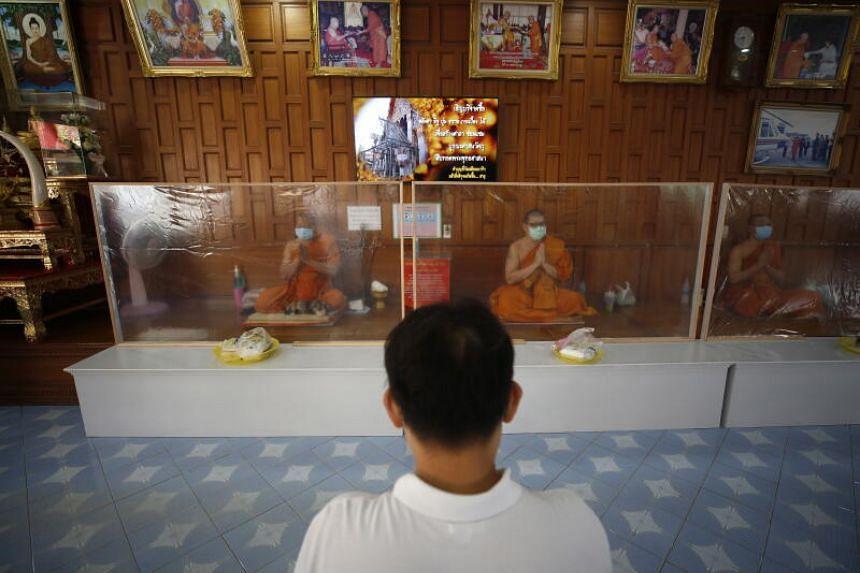Buddhist monks during the Songkran celebrations at Wat Samian Nari in Bangkok on April 14, 2020.