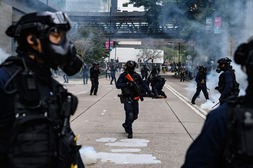 Police fire tear gas to disperse a crowd gathered for a rally at Chater Garden in Hong Kong, on Jan 19, 2020.
