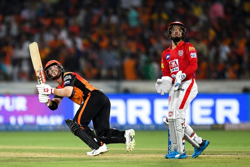 Sunrisers Hyderabad cricketer David Warner (left) looks up as he plays a shot during the 2019 Indian Premier League (IPL) match , on April 29, 2019.