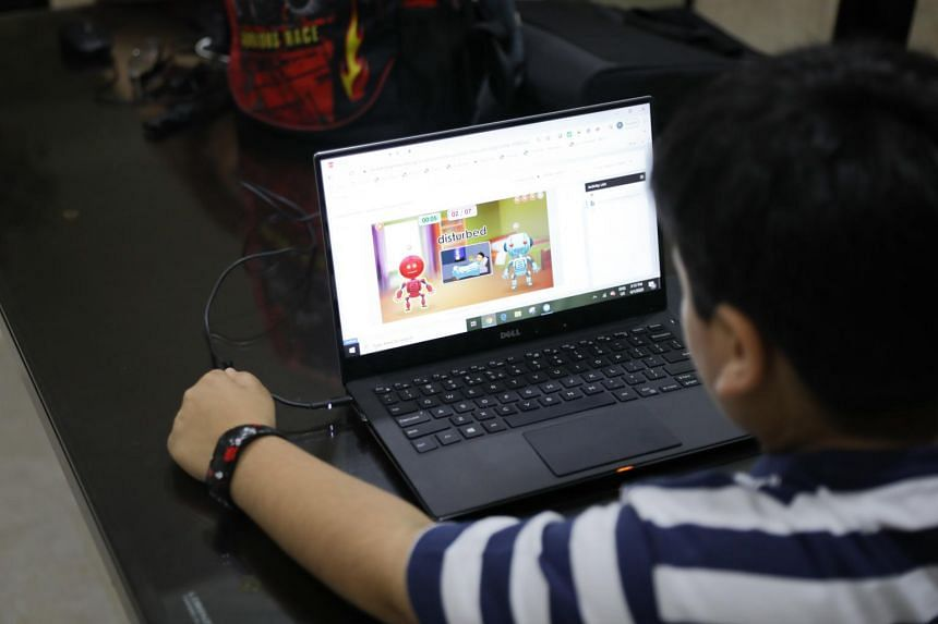 A pupil doing home-based learning at home.