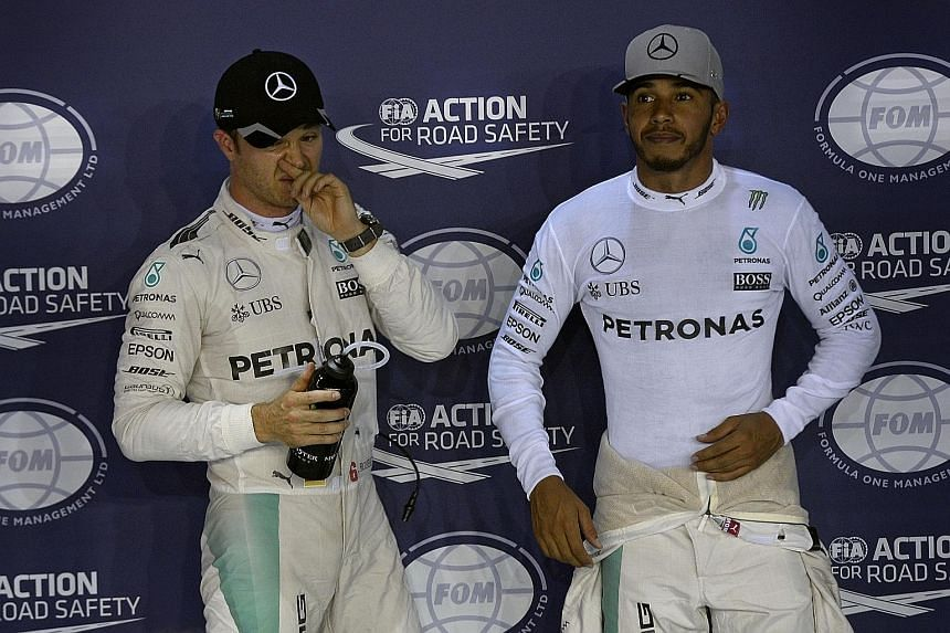 Mercedes F1 drivers Nico Rosberg and Lewis Hamilton after qualifying at the 2016 Singapore Grand Prix. The German retired at the end of that season after winning his sole drivers' title.
