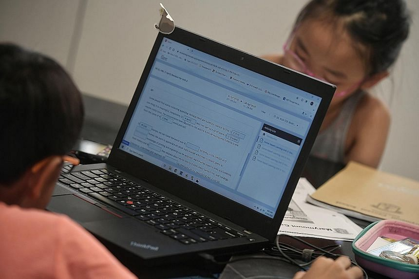 Children studying at home earlier this month. StarHub's Internet service faced intermittent outage issues yesterday, causing disruption to users working and studying at home during a period when connections are crucial amid the coronavirus outbreak.