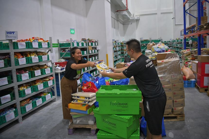 The Food Bank Singapore staff sorting out donated food on Dec 26, 2019.