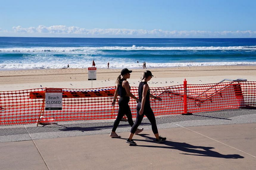Walkers exercise in Australia on April 16, 2020.