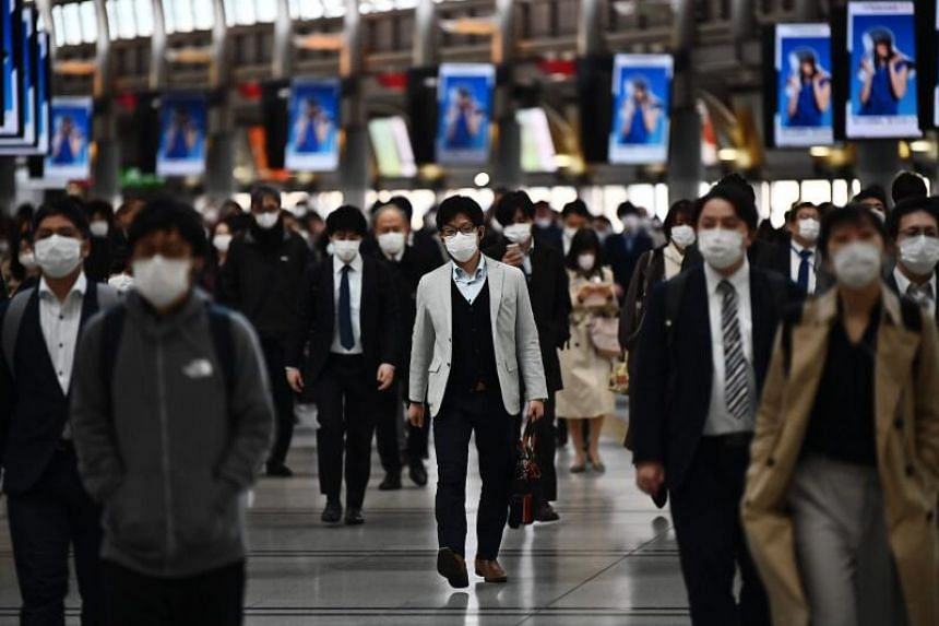 People commute to work in Tokyo despite a state of emergency in Japan, on April 16, 2020.