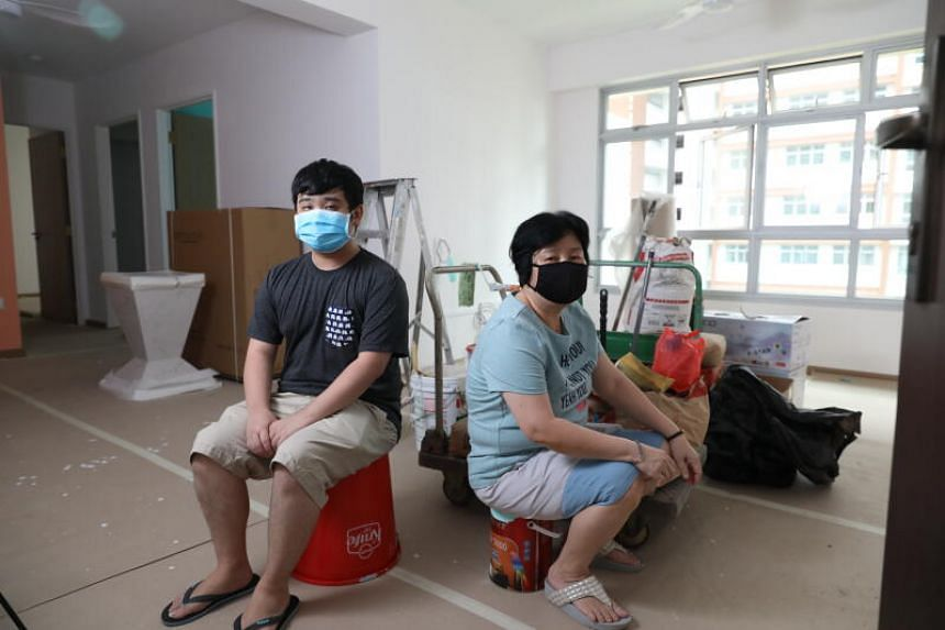 Madam Susie Koh (right) and her son, Mr Joshua Tan, in their half-renovated flat in Sengkang.
