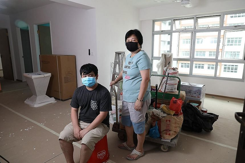 Madam Susie Koh and her son Joshua Tan in their half-renovated four-room BTO flat in Sengkang. Home renovation works have been halted due to the circuit breaker measures.