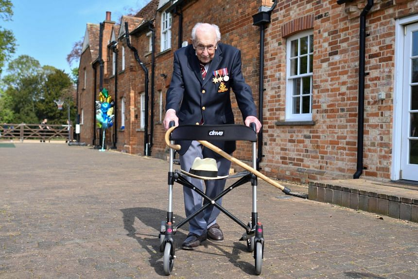 Captain Tom Moore poses with his walking frame in the village of Marston Moretaine, on April 16, 2020.