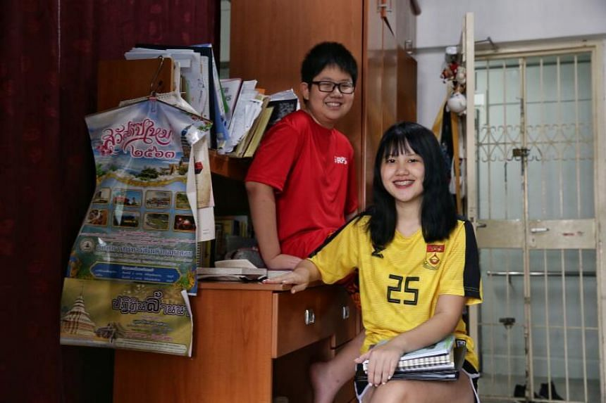 Loh Miao Xin (right), 17, and her brother, Khim San, 12, in their home on April 11, 2020.
