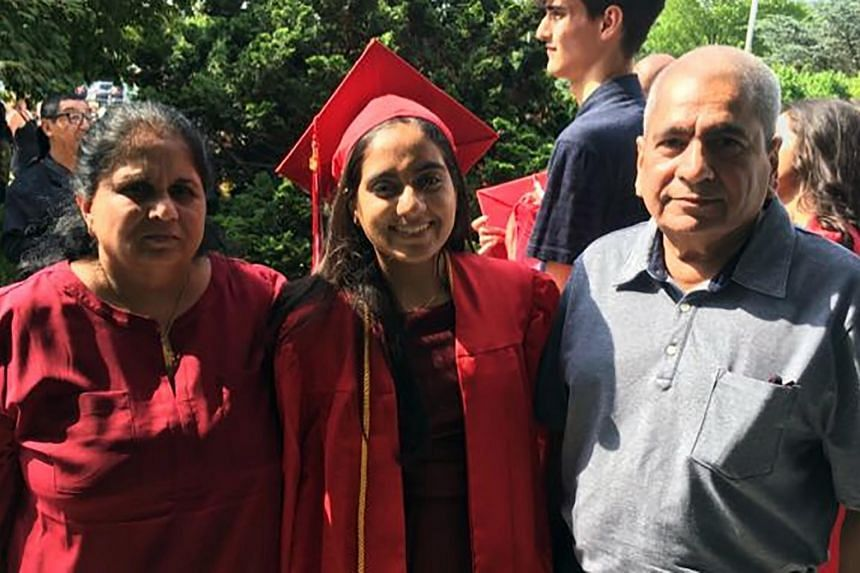 Madhvia Aya (left) and her husband,at her daughter's graduation in Floral Park, New York, on June 2019.