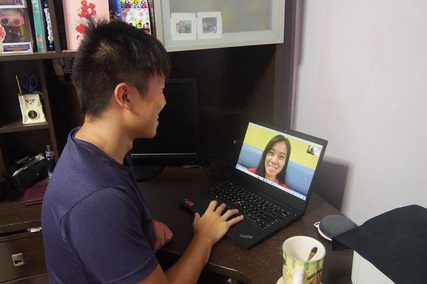 Mr Edward Tan chats with his girlfriend, Ms Priscillia Chen.
