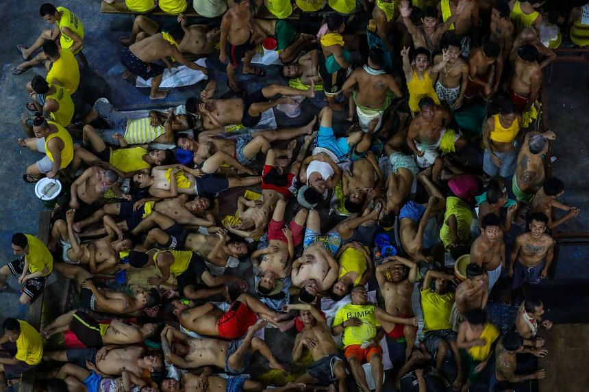 A photo from March 27, 2020, shows prison inmates in cramped conditions in the crowded courtyard of the Quezon City Jail in Manila.