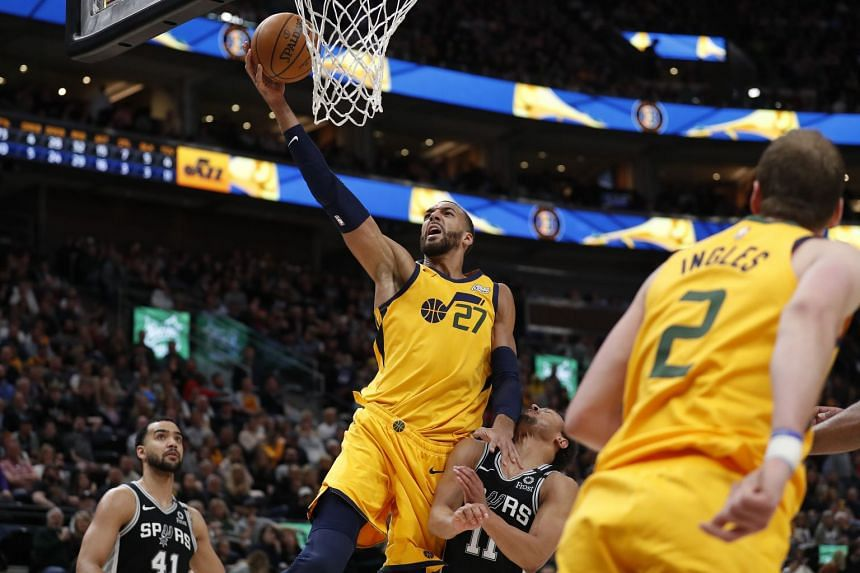National Basketball Association and players' union agree on 25% wage cut
