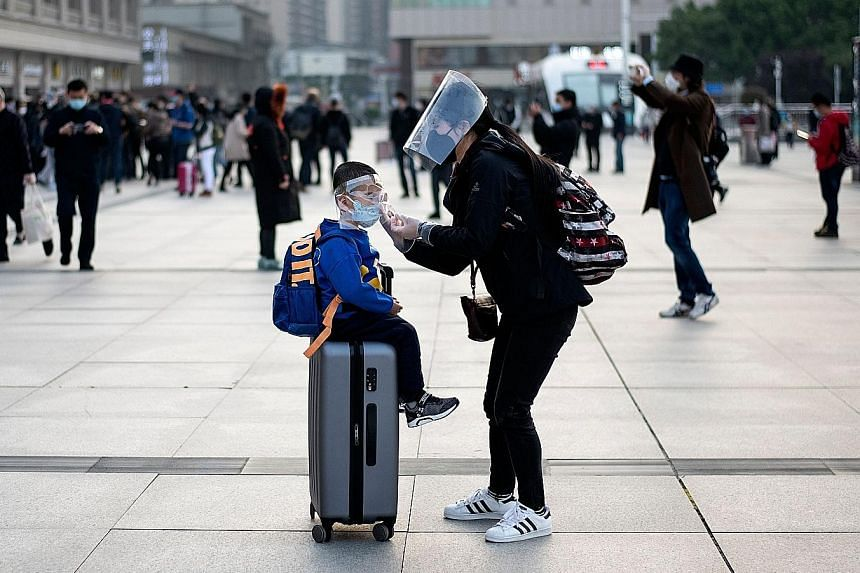 A woman and her son at Hankou railway station in Wuhan, the Chinese city where the coronavirus first emerged late last year. Infectious diseases expert Wang Linfa says the coronavirus responsible for Covid-19 is one of several viruses that likely ori
