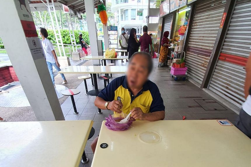 The man who slapped an officer consuming food at a hawker centre in Circuit Road on April 15, 2020.