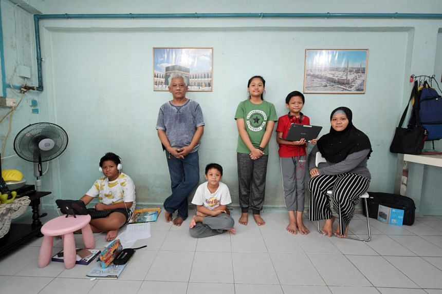 Mr Hashim Kamid (second from left), his wife Salmiah Salam (right) and their four children all live together in their flat in Lengkok Bahru.