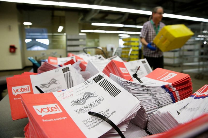 Empty envelopes of opened vote-by-mail ballots for the presidential primary at King County Elections in Renton, Washington on March 10, 2020.