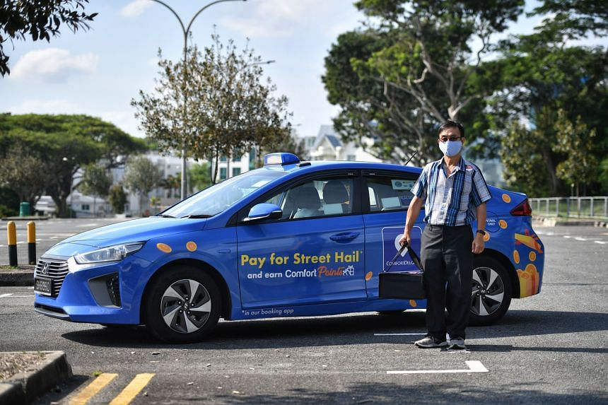 Cabby Toh Kian Seng, 57, with a KFC delivery order yesterday. The experience of delivering food orders is new to him, but he said it is better than plying streets bereft of passengers, given the circuit breaker measures. ComfortDelGro has close to 11