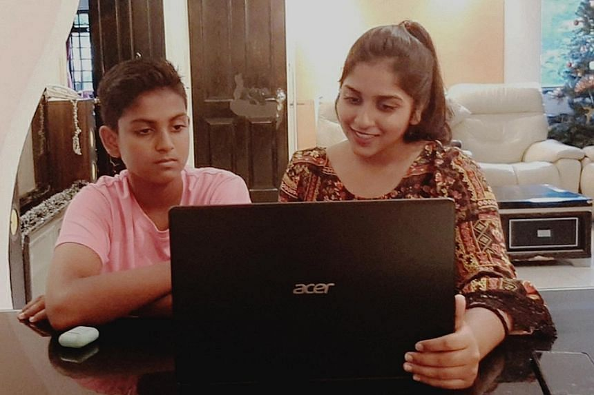 Sheryl Shivani, with her brother Gerald Giresh Raj, says she can complete her online assignments faster now that she has a laptop. In the past, she relied on her mobile phone, which could not support all the features she needed for e-learning.