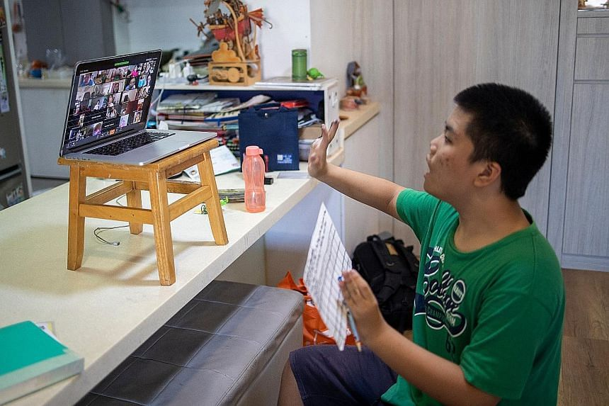 Left: Lee Jun Le, 13, taking part in Superhero Me's dance video conferencing session with other children, both with and without special needs.Below: Pathlight School pupil Maximilian So, 11, following moves shown in a video during a physical educatio
