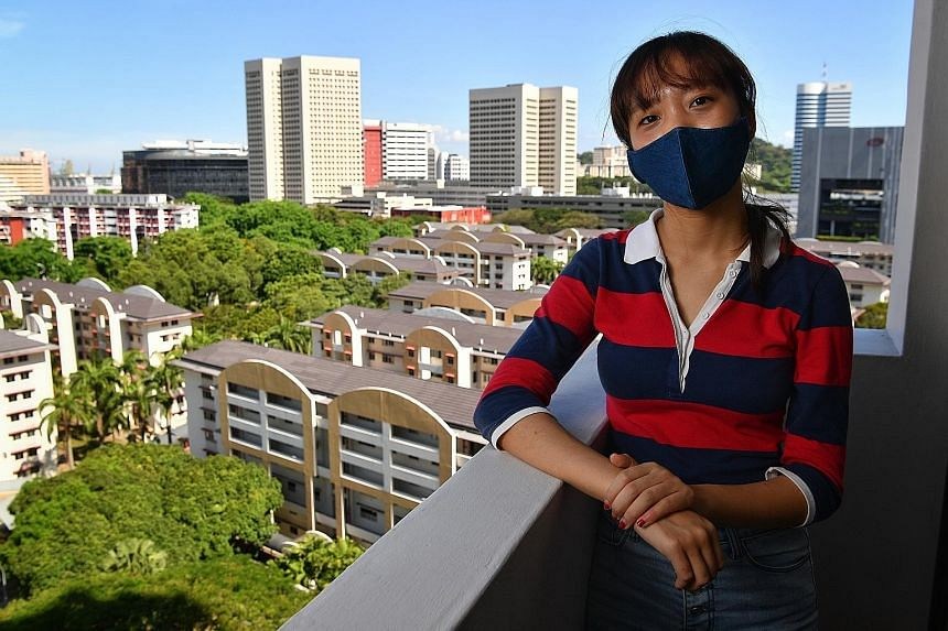 Redhill resident Ethel Pang, 22, is a Wimby, or Welcome In My Backyard, ambassador. She has already engaged family members about workers in the estate and hopes to reach more via the grassroots network. ST PHOTO: CHONG JUN LIANG