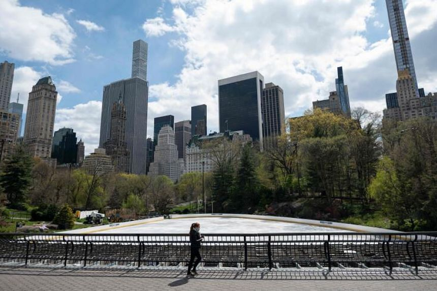 A woman walks in a deserted Central Park in New York City on April 16, 2020.