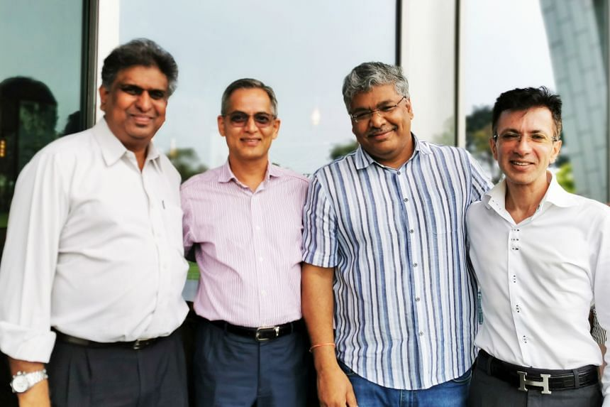 (From left) COO Vinod Martin, CEO Balwant Jain and MDs K. Saravanan and Sumit Malik. PHOTO: OPTIMUM SOLUTIONS
