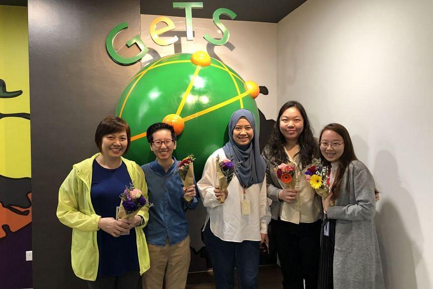 CrimsonLogic's subsidiary, GeTS, celebrating International Women's Day and showing appreciation towards its female staff. PHOTO: CRIMSONLOGIC