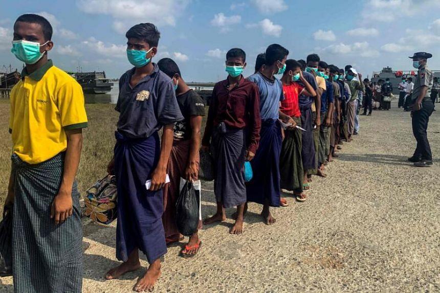 Released Rohingya prisoners arrive at Sittwe jetty in Myanmar's Rakhine state on April 20, 2020.