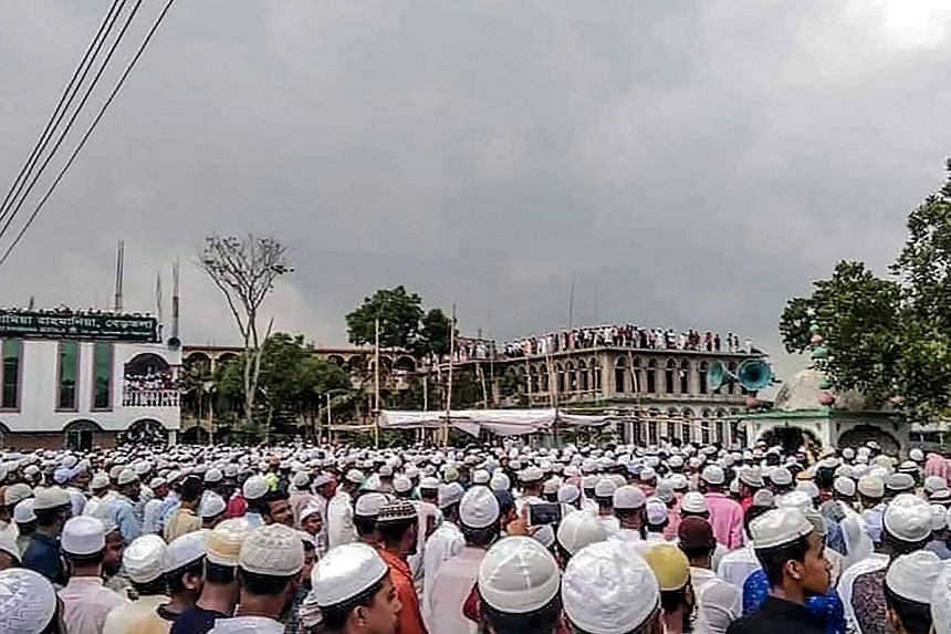 Muslim devotees attending the funeral of popular cleric Maulana Jubayer Ahmed Ansari in Brahmanbaria district, Bangladesh, last Saturday, during a government-imposed nationwide lockdown to halt the spread of Covid-19. The massive gathering has raised