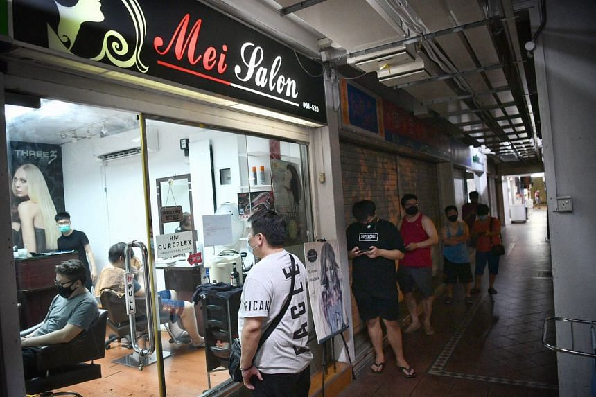 A queue at a hair salon in Tampines Street 81 at around 9.30pm on April 21, 2020.