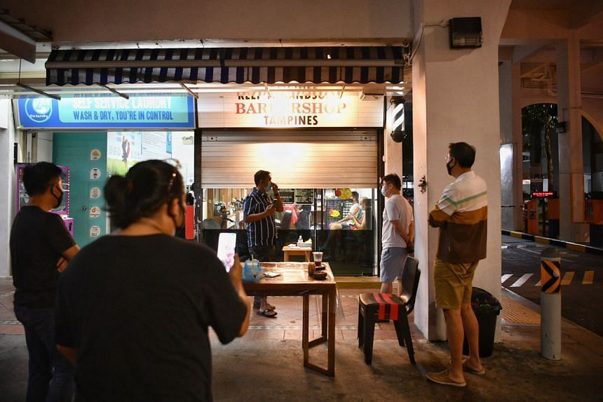 A queue at a barber shop in Tampines Street 81 at around 9.30pm on April 21, 2020.
