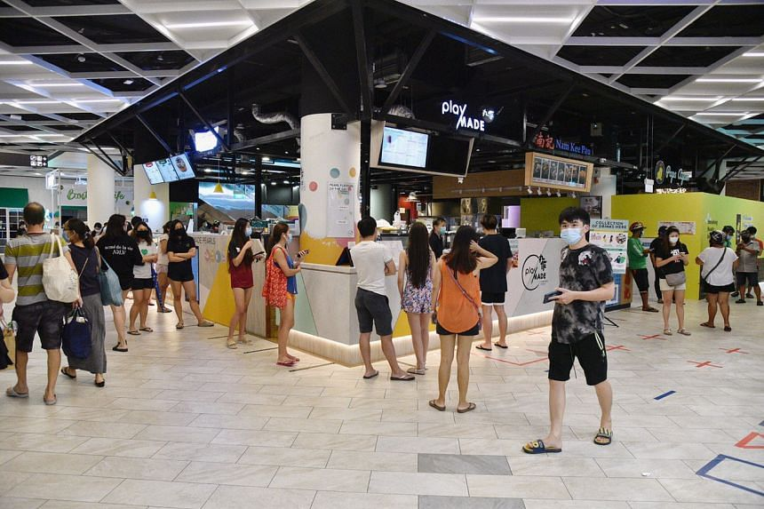 A queue at the PlayMade outlet in PLQ Mall on April 21, 2020.