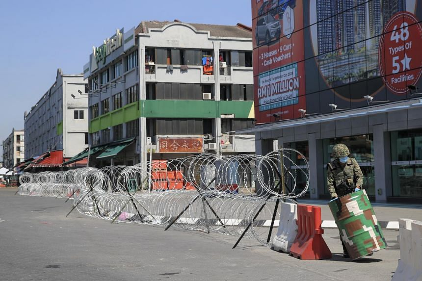 A Malaysia army personnel blocks the entrance to a locked down area in Kuala Lumpur, on April 21, 2020.