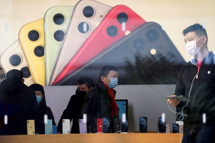 People are seen in an Apple Store in Shanghai, China, Jan 29, 2020.