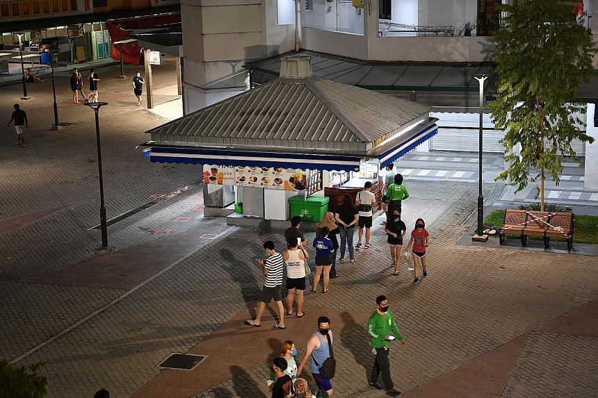 A queue forming at a bubble tea and dessert shop in Tampines Street 81 at about 9.30pm yesterday as more businesses were told to close by midnight. ST PHOTO: ARIFFIN JAMAR