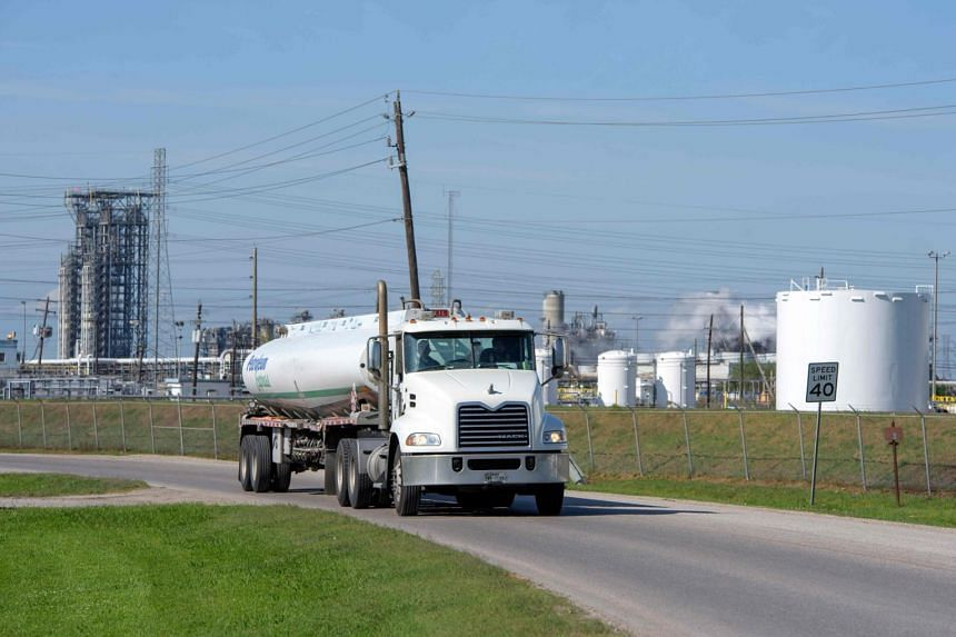 A truck drives past an oil storage facility in Houston, Texas, on April 21, 2020.