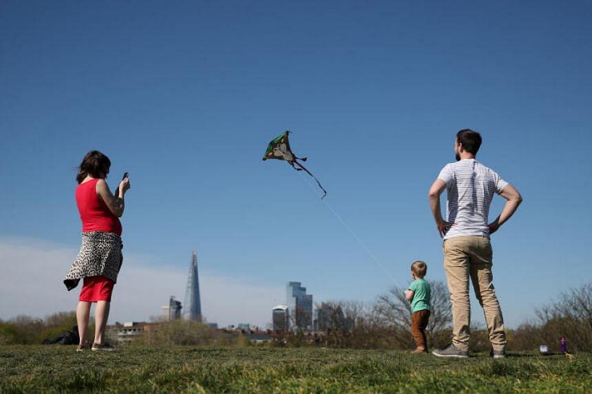 People seen flying a kite in London's Burgess Park on April 5, 2020.