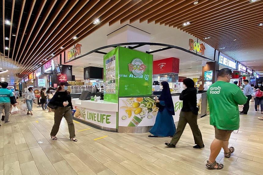 Jem shopping mall, where the Boost fruit juice outlet was closed yesterday. The list of services considered essential and allowed to open was trimmed to exclude some F&B outlets as well as barbers and other businesses, effective yesterday.