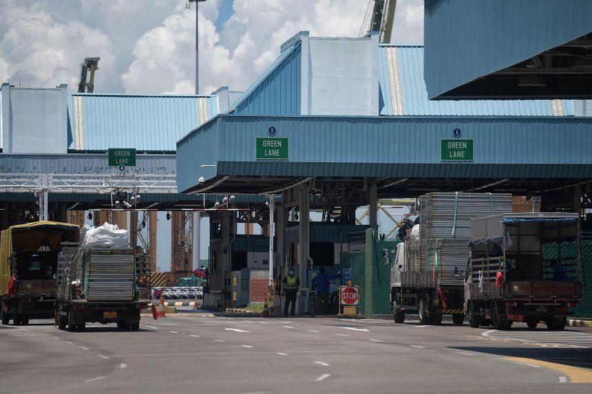 Trucks carrying building materials waiting to enter Tanjong Pagar Terminal on April 20, 2020.