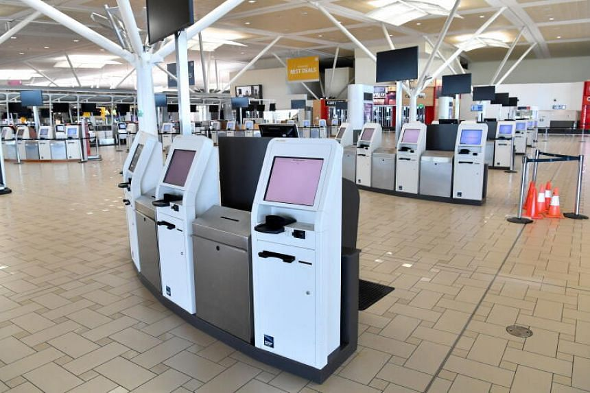 Empty check-in counters at the international airport in Brisbane, on April 17, 2020.