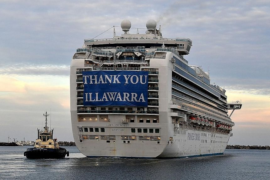 The cruise ship Ruby Princess leaving a port near Sydney yesterday after a few hundred virus-free employees disembarked.
