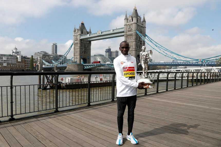In a photo from April 29, 2019, London Marathon elite men's winner Eliud Kipchoge poses with the trophy.