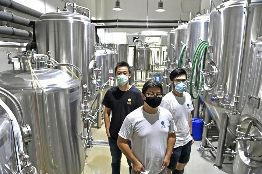 Digital payments have sharpened work processes at Off Day Beer Company, said co-founders Kasster Soh (top left), Kevin Ngan and Daryl Yeap (right). The company had been using PayNow Corporate through OCBC Bank since Dec 2019.