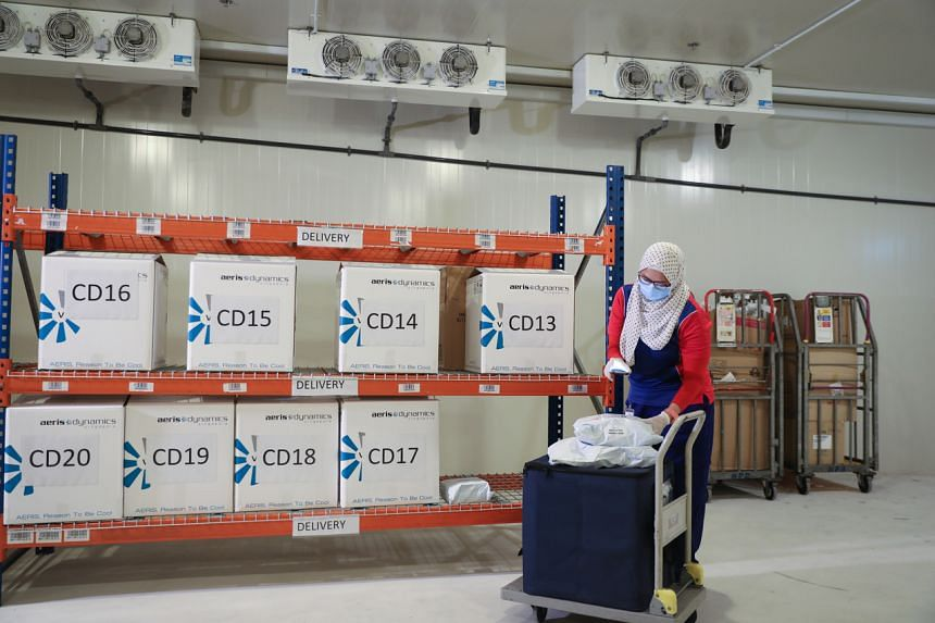 Speedpost courier Ismadiana Samsudin collecting a cold-chain box for delivery. Speedpost delivers medicines to about 300 patients daily.