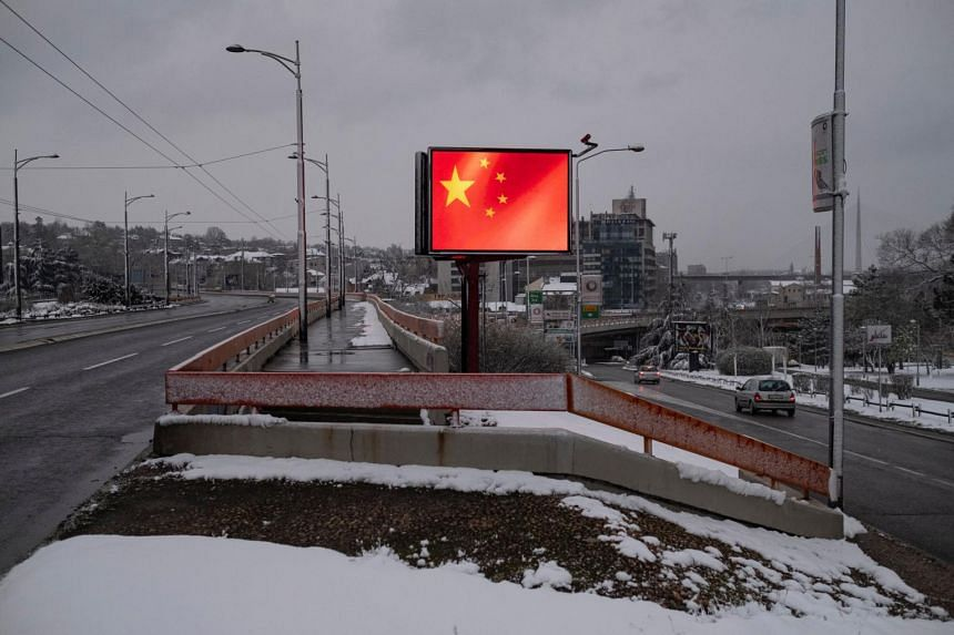 In a photo from March 24, 2020, a Chinese flag is displayed on a billboard in gratitude to China in Belgrade, Serbia.